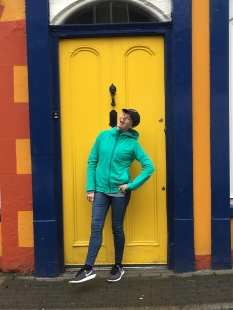 Posing in front of a yellow door